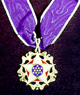 The medal is presented ceremonially as a neck order.