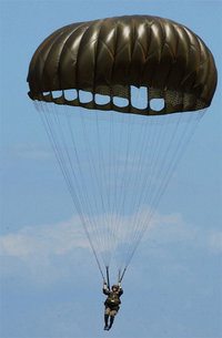 An American Paratrooper using a T-10C series parachute