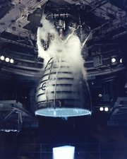A remote camera captures a close-up view of a Space Shuttle Main Engine during a test firing at the  in