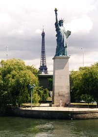 The  copy on the river  in Paris, France. Given to the city in 1885, it faces west, toward the original Liberty in .